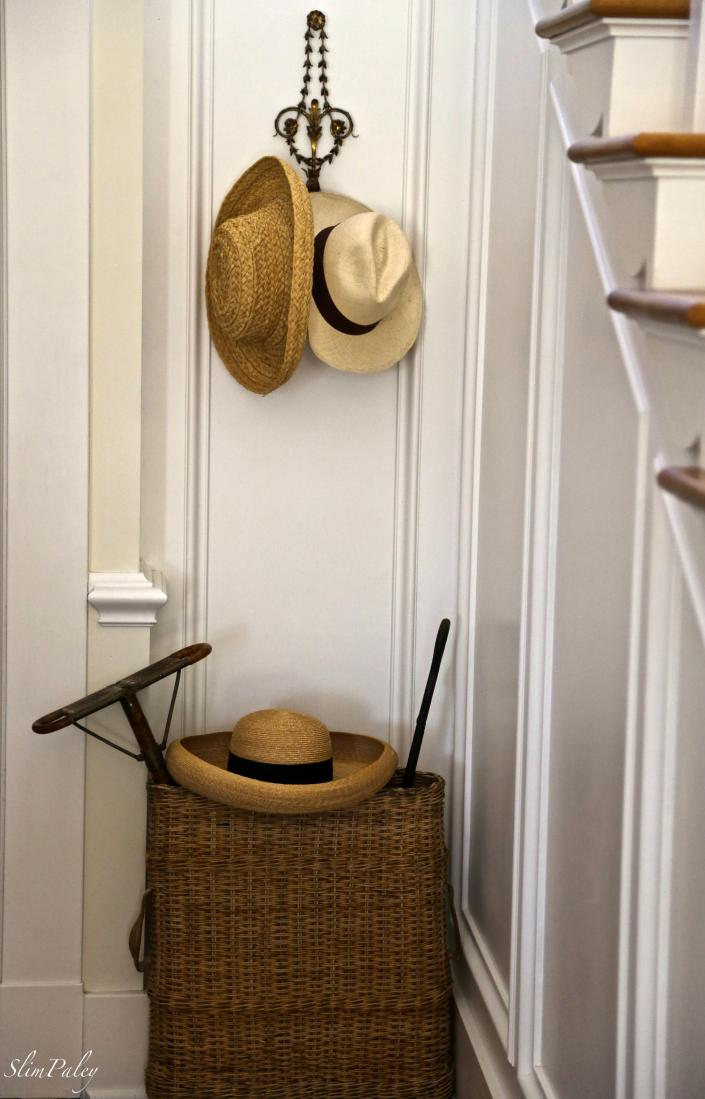 Straw hats in the hall, Slim Paley