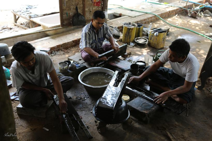 men working on a lacquer table