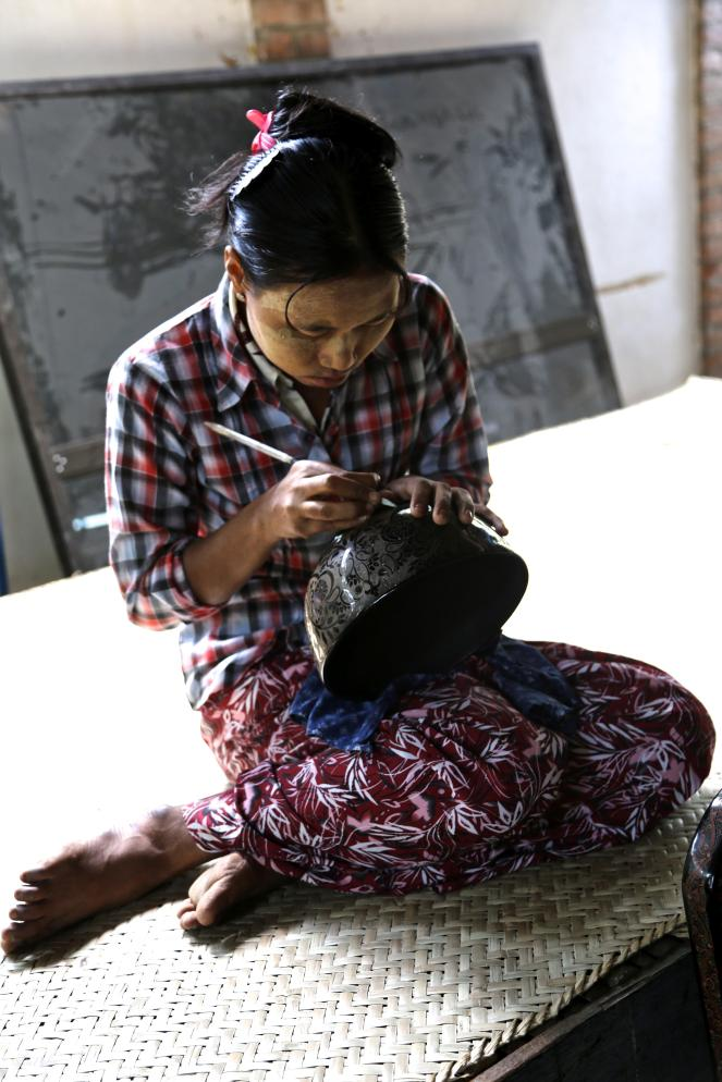 woman carving lacquer