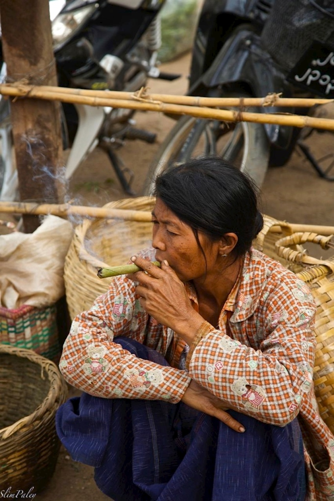 Woman smoking, Burma, slimpaley.com